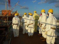 A team of officials from the Nuclear Regulatory Commission visits the spent fuel pool of reactor 4 at the Fukushima Dai-ichi complex. (Photo courtesy of TEPCO via NRC)
