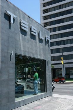 In conceiving its showrooms, electric car maker Tesla Motors looked to leaders in consumer electronics, particularly Apple. (Photo credit: Flickr user mil8)
