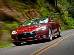 One of the first Model S electric sedans from Tesla Motors hits the road. (Photo credit: Tesla Motors)