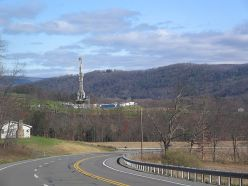 Equipment used in natural gas operations stands atop the Marcellus shale in Pennsylvania. (Photo credit: Wikimedia Commons user Ruhrfisch)